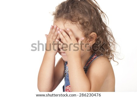 A beautiful girl covering her eyes #286230476