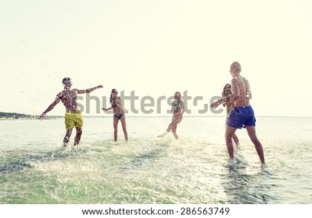 friendship, sea, summer vacation, holidays and people concept - group of happy friends having fun on summer beach #286563749