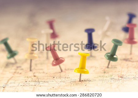 Travel concept with several pushpins on map,color filter effect Royalty-Free Stock Photo #286820720