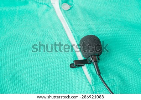 Close-up of  holding a Wireless lavalier microphone