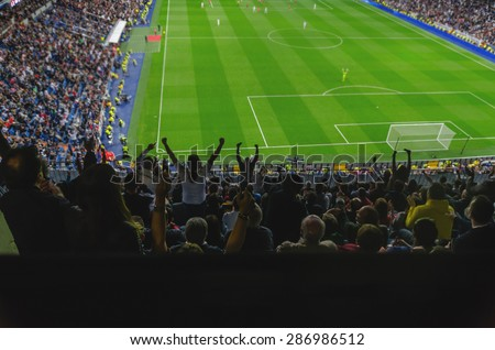 Goal celebration. Soccer. Football. A goal is celebrated for the supporters of a team in a soccer stadium. Happy soccer fans are celebrating a goal.  Royalty-Free Stock Photo #286986512