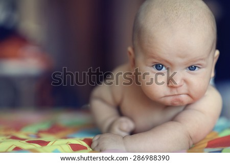 portrait serious stern baby Royalty-Free Stock Photo #286988390