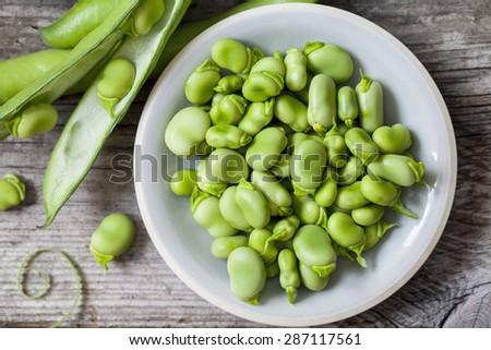 Fresh broad beans Royalty-Free Stock Photo #287117561