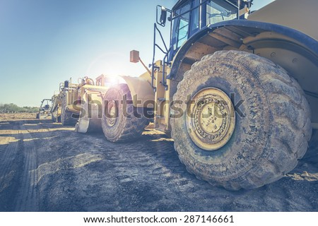Digger bulldozer on construction site Royalty-Free Stock Photo #287146661