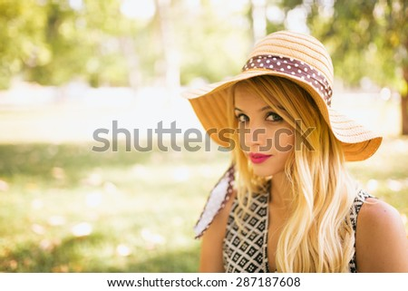 Portrait of young blonde woman in nature. #287187608