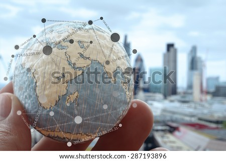 close up of businessman hand showing texture the world with digital social media network diagram concept Elements of this image furnished by NASA london city background Royalty-Free Stock Photo #287193896