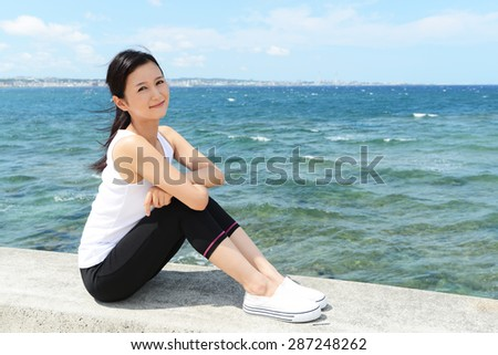 Relaxed woman sitting by the sea #287248262