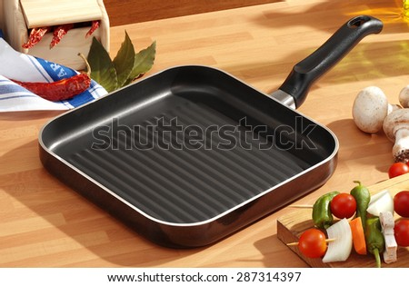 square grill pan on the kitchen table ready to grill brochettes #287314397