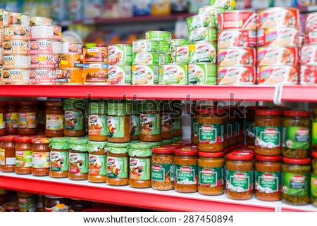 BARCELONA, SPAIN - MARCH 22, 2015: Shelves with canned goods at groceries section of average Polish supermarket  #287450894