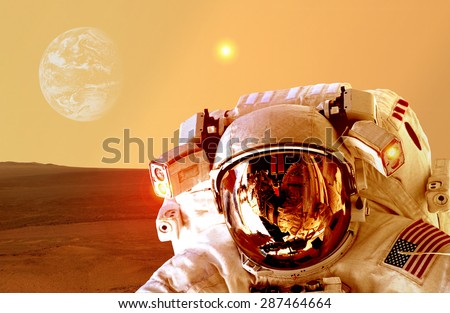 Astronaut spaceman helmet space planet Mars apocalypse Earth. Elements of this image furnished by NASA.
