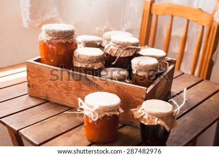 Picture of home made jam  in jars. Homemade preserves (conserve) concept in country kitchen. Rustic style. Royalty-Free Stock Photo #287482976