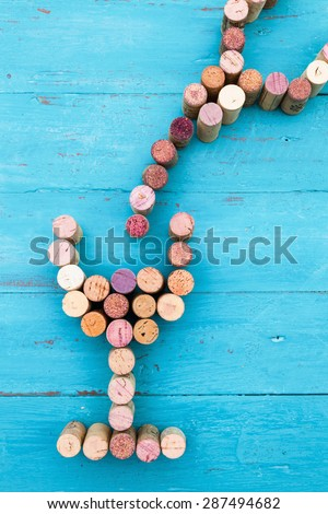 conceptual picture of a wine glass and bottle made from wine corks