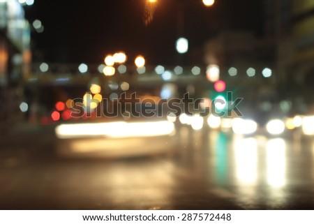 Blurred bokeh of car in city at night #287572448