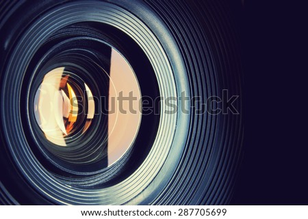 Camera lens. Retro stale. Royalty-Free Stock Photo #287705699
