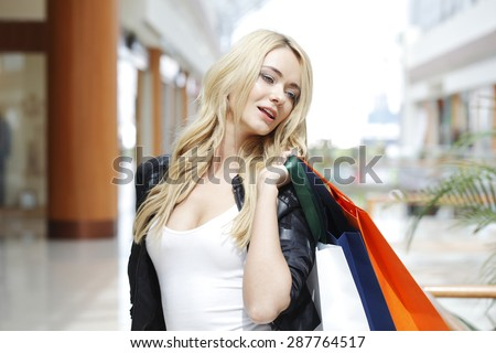 Fashion shopping woman walking with bags in shopping mall #287764517