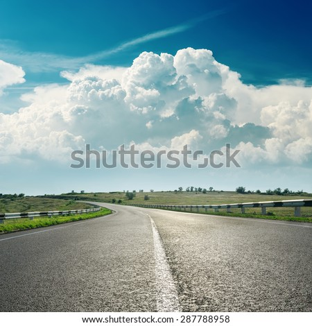 asphalt road to horizon and clouds over it #287788958