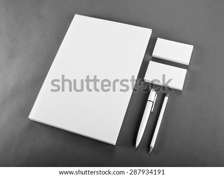 Blank Stationery on gray background. Consist of Business cards, A4 letterheads, pen and pencil