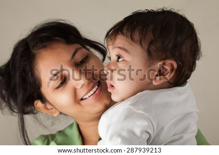 Close up of a Indian happy mother looking at her baby with love #287939213