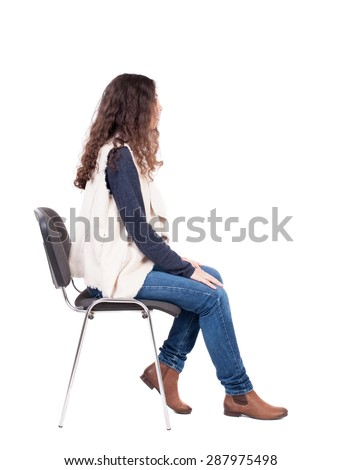 back view of young beautiful  woman sitting on chair.  girl  watching. Rear view people collection.   girl in a white tank top sitting on a stool and looking to the right. #287975498