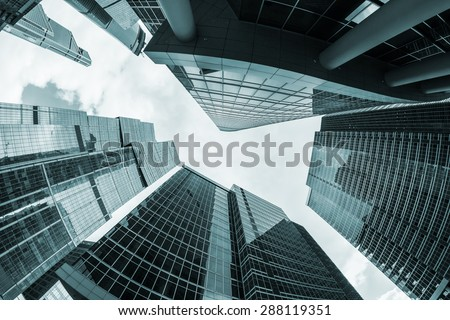 futuristic modern skyscrapers of glass and metal. Focus on the top of the building. toned photo #288119351