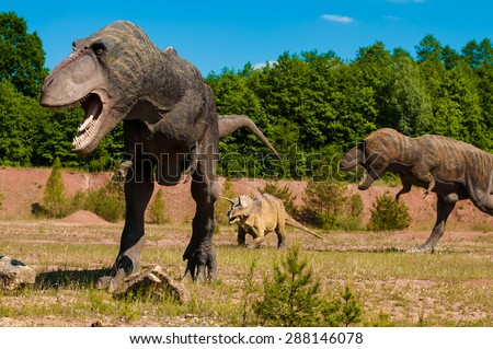 Photo of real dinosaurs in the wild land