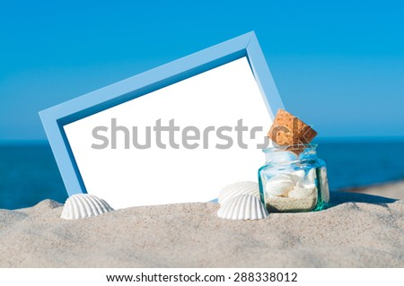 Blank blue picture frame in sandy beach with maritime decoration
