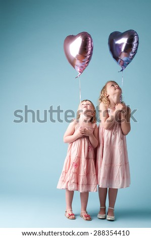 Two cute girls playing with balloons #288354410