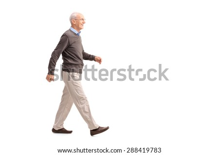Full length profile shot of a casual senior man walking and smiling isolated on white background #288419783