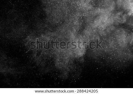 abstract white dust explosion  on a black background.  Royalty-Free Stock Photo #288424205