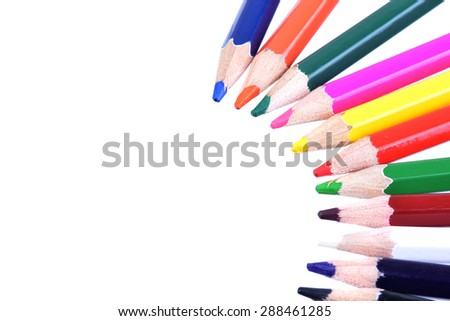 Macro shot of several color pencils on white #288461285
