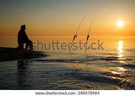 Sunset on  Lake Superior near Pictured Rock National Lake Shore Michigan State with silhouette of fisherman