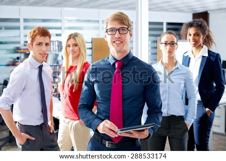 Blond young businessman multi ethnic teamwork group as leader in office #288533174