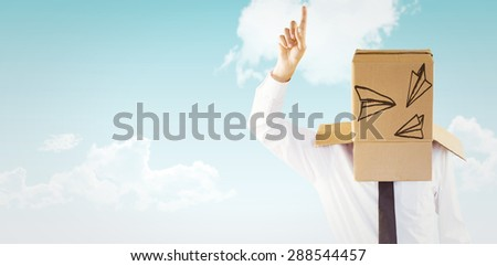 Anonymous businessman with hand pointing up against blue sky #288544457