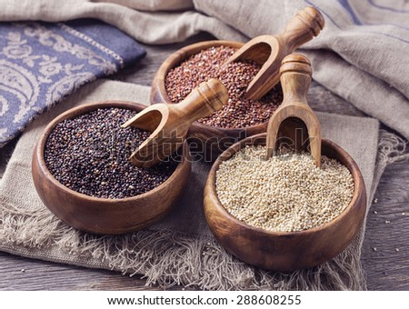 Red, black and white quinoa seeds on a wooden background #288608255