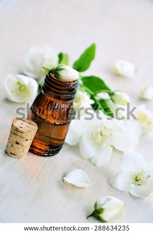 aromatic jasmine oil on a wooden background #288634235