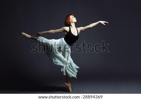 Ballet dancer performing on stage. #28894369