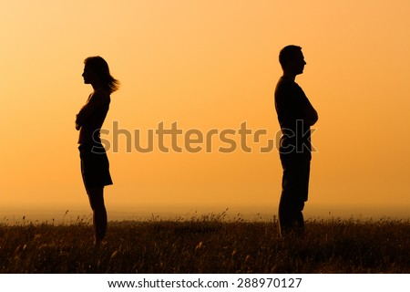 Silhouette of a angry woman and man on each other.Relationship difficulties Royalty-Free Stock Photo #288970127
