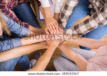 Circle of trust. Group of people sitting in circle and supporting each other. #289042967
