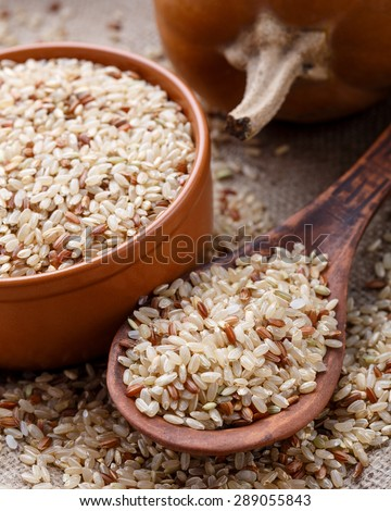 The raw rice mix on the wooden spoon #289055843