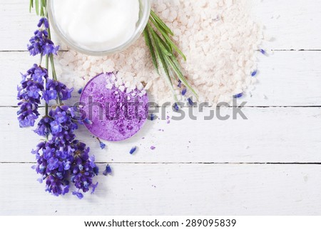 beauty product samples and lavender on white wooden table background #289095839