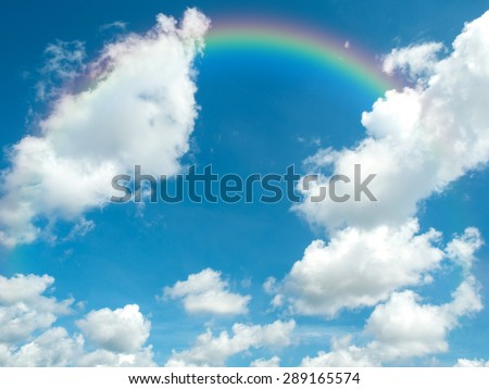 Beautiful blue sky  and  white clouds with rainbow in summer day. Photo for background.
