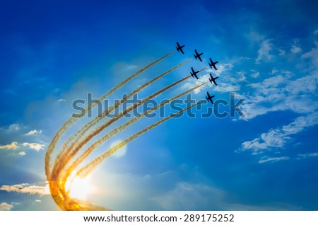 Airplanes on airshow. Aerobatic team performs flight at air show #289175252