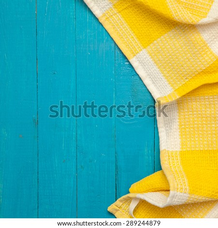 yellow towel in a cage on a blue wooden background #289244879