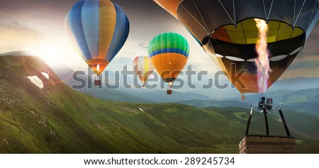 Colorful balloons flying in the mountain #289245734