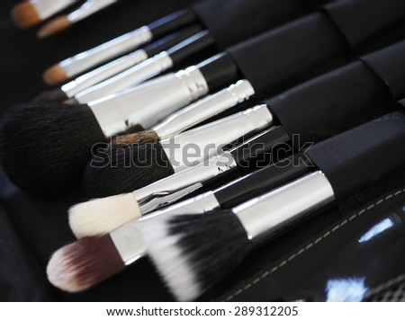 Closeup of makeup tools in their holder #289312205