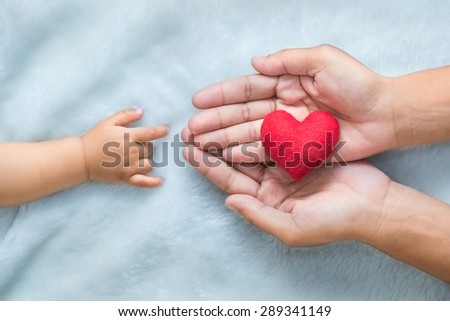 baby and mothers hands made symbol of love. #289341149