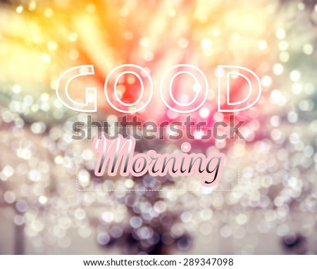 Good Morning typographic word on  winter tree and glitter bokeh lights background, vintage and retro style image