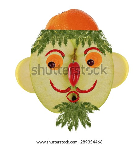 Creative food concept. Funny portrait made of  apples, vegetables and fruit.