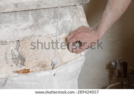 miller checks the flour in the corn mill #289424057