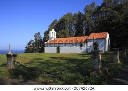Hermitage of San Antonio de Corveiro, Cedeira, A Coruña, Galicia, Spain, cruceiro, views of the Atlantic Ocean, white church surrounded by green meadows and eucalyptus, place of Roman pilgrimages  #289426724
